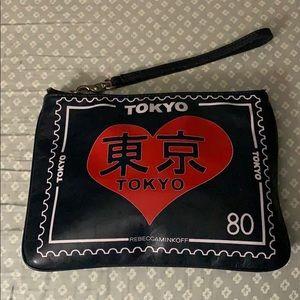 Tokyo 80 zip up bag by Rebecca Minoff